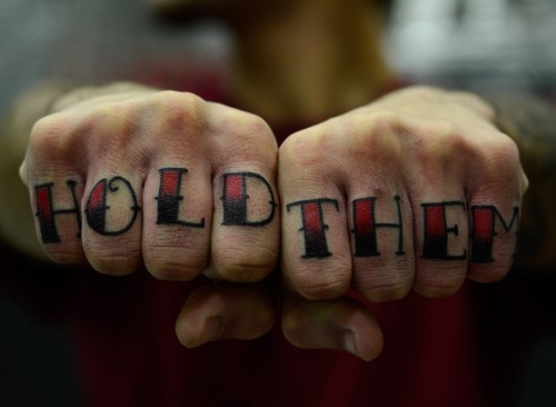 Hold Them Knuckle Tattoo
